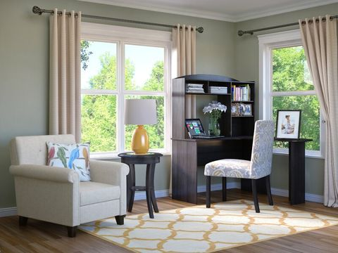 home office with chairs, desk, rug, and windows