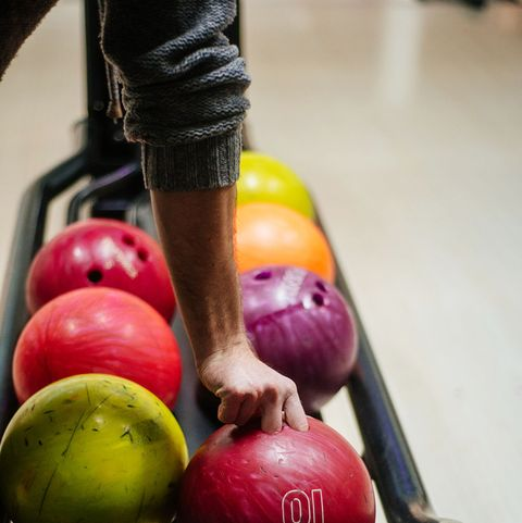Man Taking A Bowling Ball