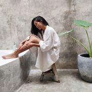 woman in bathrobe in luxury bathroom