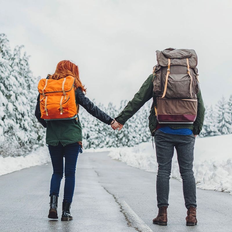 Happy Couple Travelling With A Backpack