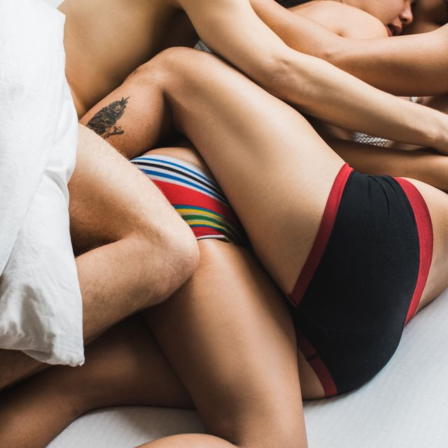 three people in bed together