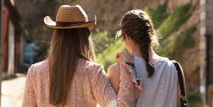 Back View Of Stylish Cowgirls On Nature