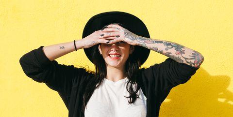 Yellow, Hat, Sun hat, Fashion accessory, Headgear, Cool, Sombrero, Fun, Gesture, Photo shoot,