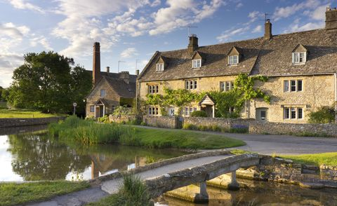 cotswolds stone bridge and cottage, lower slaughter