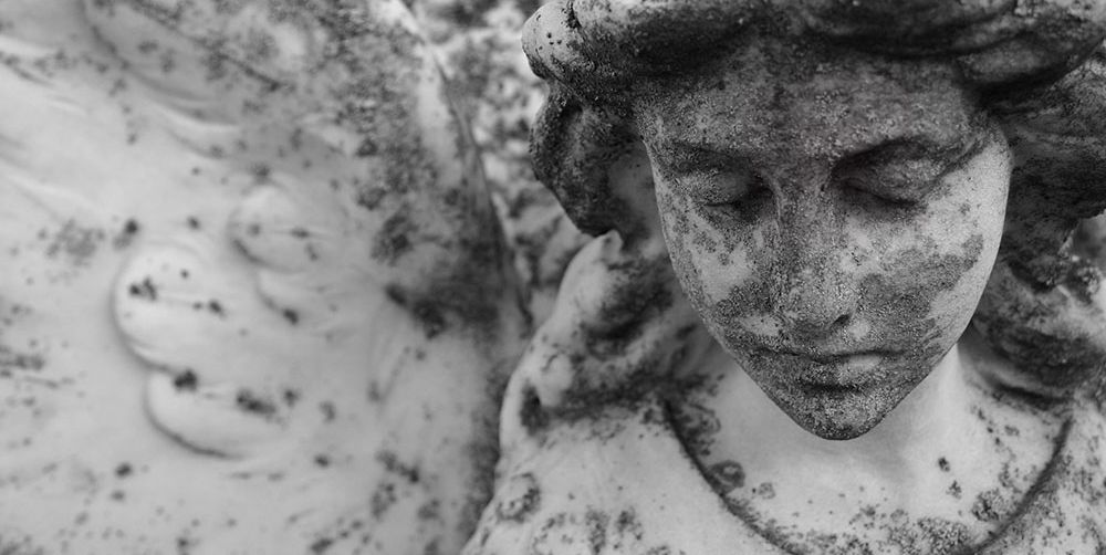 stone angel with cracked face