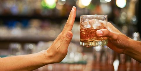 stop drinking,stop drinking conceptman alcoholic social problems sitting at table refusal of alcohol say no to addiction close up