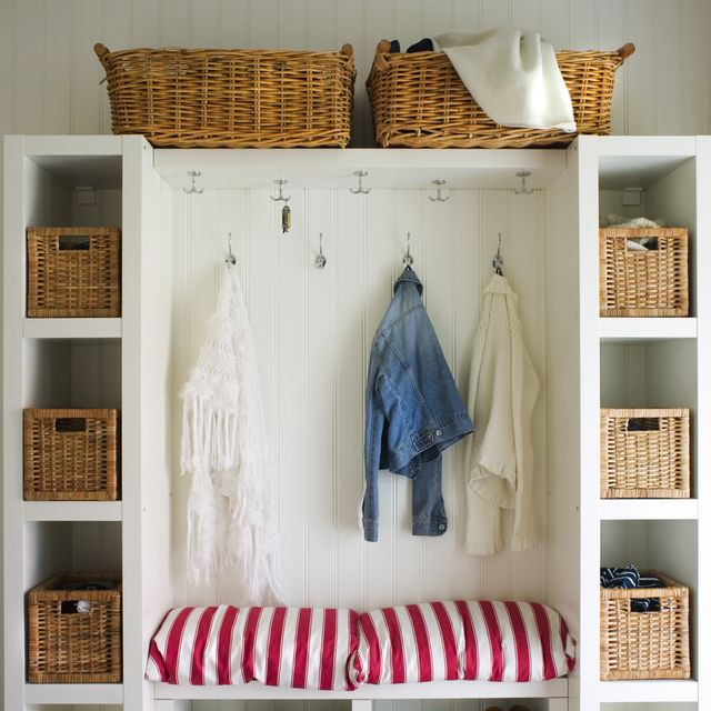a wardrobe in a hall with storage boxes