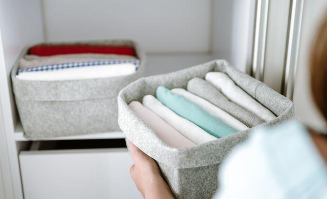 organising clothes in wardrobe