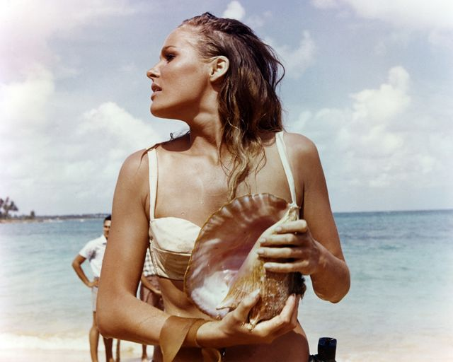 ursula andress, swedish actress, wearing a white bikini and holding a conch shell in a publicity still issued for the film, 'dr no', 1962 the james bond film, directed by  terence young 1915 1994, starred andress as 'honey ryder' photo by silver screen collectiongetty images  photo by silver screen collectiongetty images