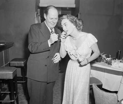 joan crawford lighting her cigarette