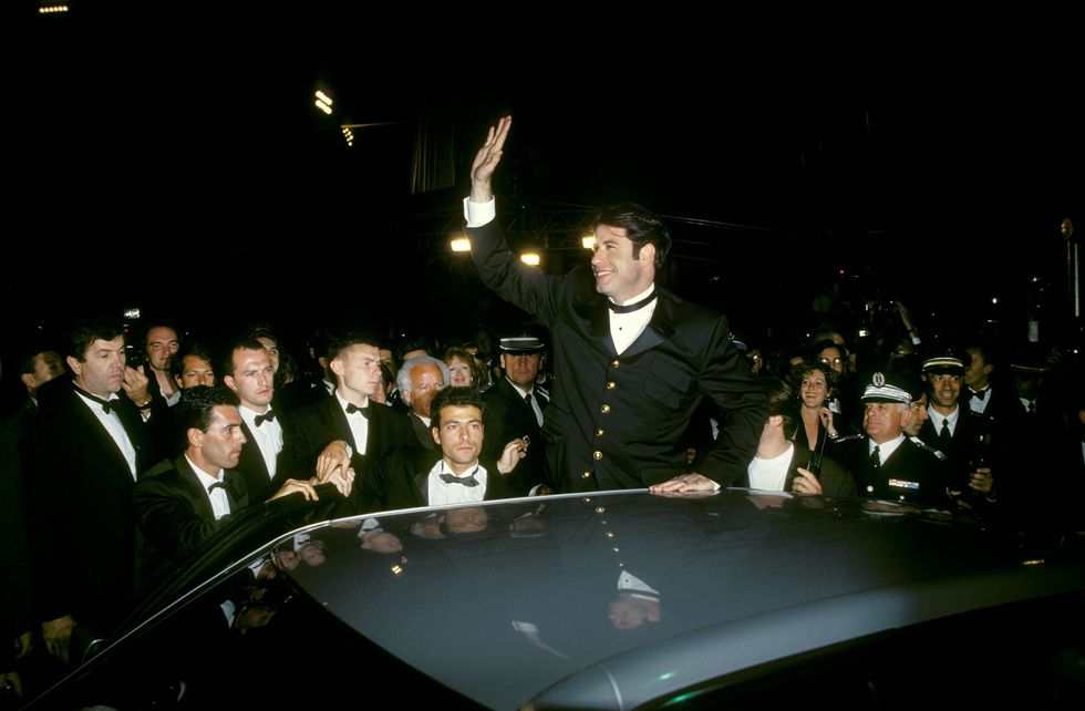 Pulp Fiction (1994) Travolta waves to fans in Cannes, France for the premiere of Pulp Fiction. Travolta credits Tarantino and his role in this movie for helping revamp his career.