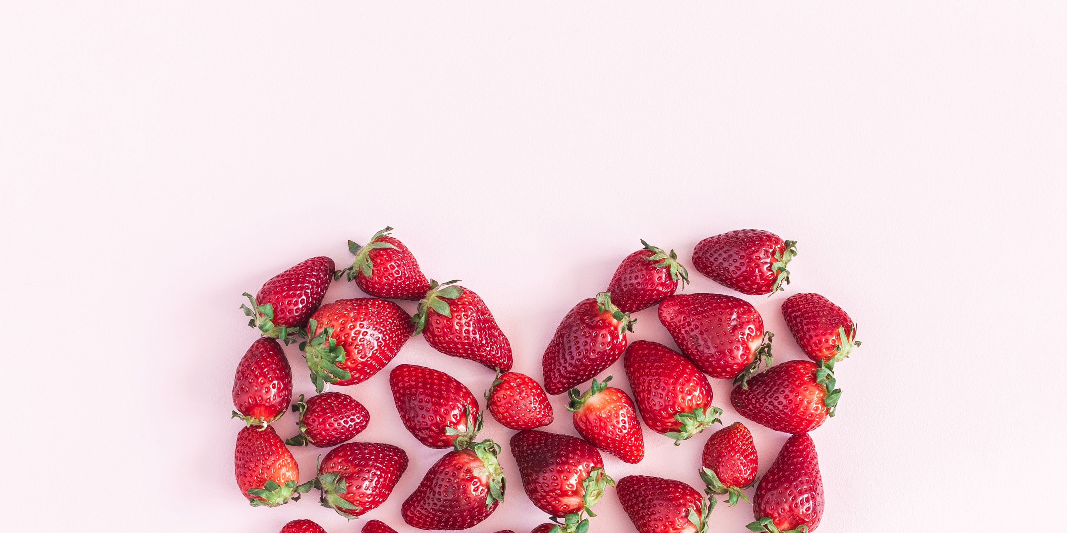 Strawberry on pink background. Flat lay, top view, square