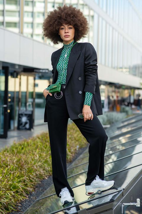 berlin, germany   october 29 julia dalia is seen wearing a black suit jacket by acne studios, a lacoste green longsleeve top, flippa k trousers with a calvin klein belt, a jacquemus mini bag, shoes by premiata and gold chains by thembones jewelry on october 29, 2019 in berlin, germany photo by brian dowlinggetty images