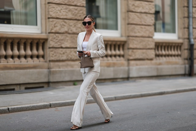 dusseldorf, germany   may 12 ann kathrin götze wearing beige joe  paul suit, amina muaddi heels, white jacquemus crop top, black dior shades and mini emma bonaventura leather bag in etoupe on may 12, 2021 in dusseldorf, germany photo by jeremy moellergetty images