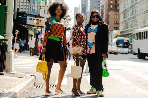 three women in fun, bright outfits for nyfw, including one in a bikini body tee