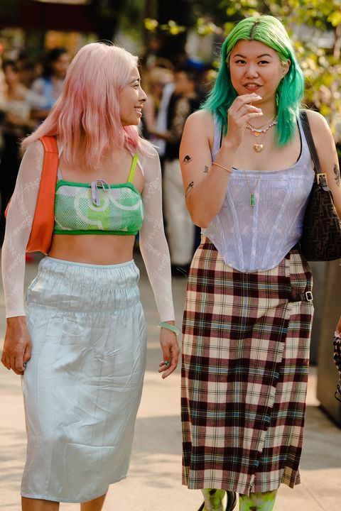 two new york fashion week attendees wearing colorful street style outfits