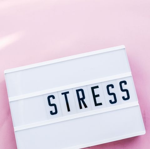 stress word in lightbox.Pink background.top view