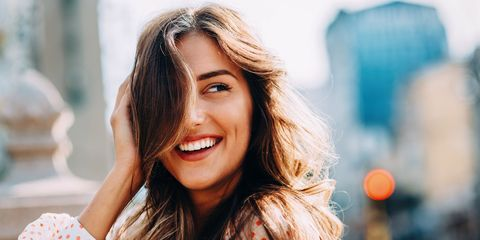 Woman smiling with teeth