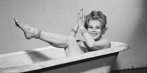 Zsa Zsa Gabor Seated In Bathtub Wearing Jewels