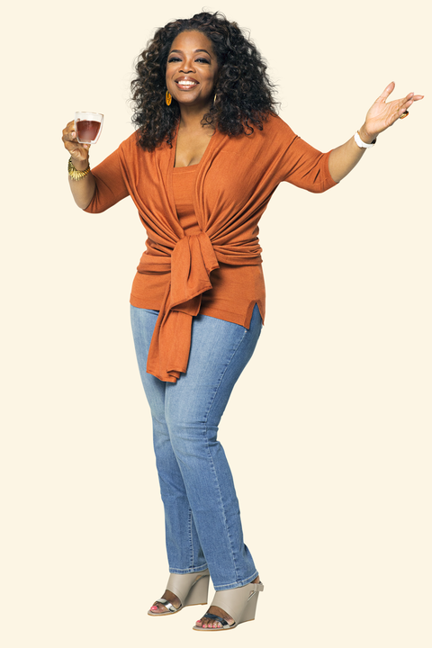 Standing, Hairstyle, Jeans, Orange, Gesture, Finger, Afro, Thumb, Long hair, Photography,