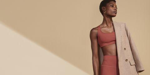 Clothing, Fashion, Fashion model, Pink, Shoulder, Outerwear, Model, Beige, Fashion design, Wrap,