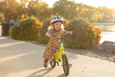 Vehicle, Bicycle, Child, Yellow, Toddler, Recreation, Cycling, Leaf, Bicycle accessory, Autumn,