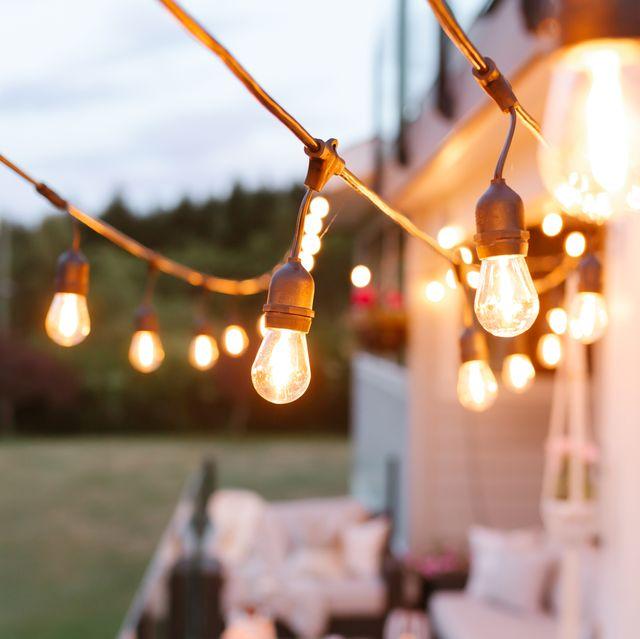 string lights over deck outside house