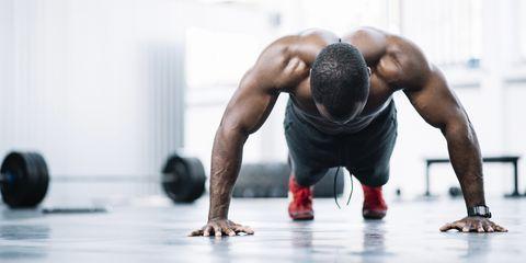 strong black man doing pushups