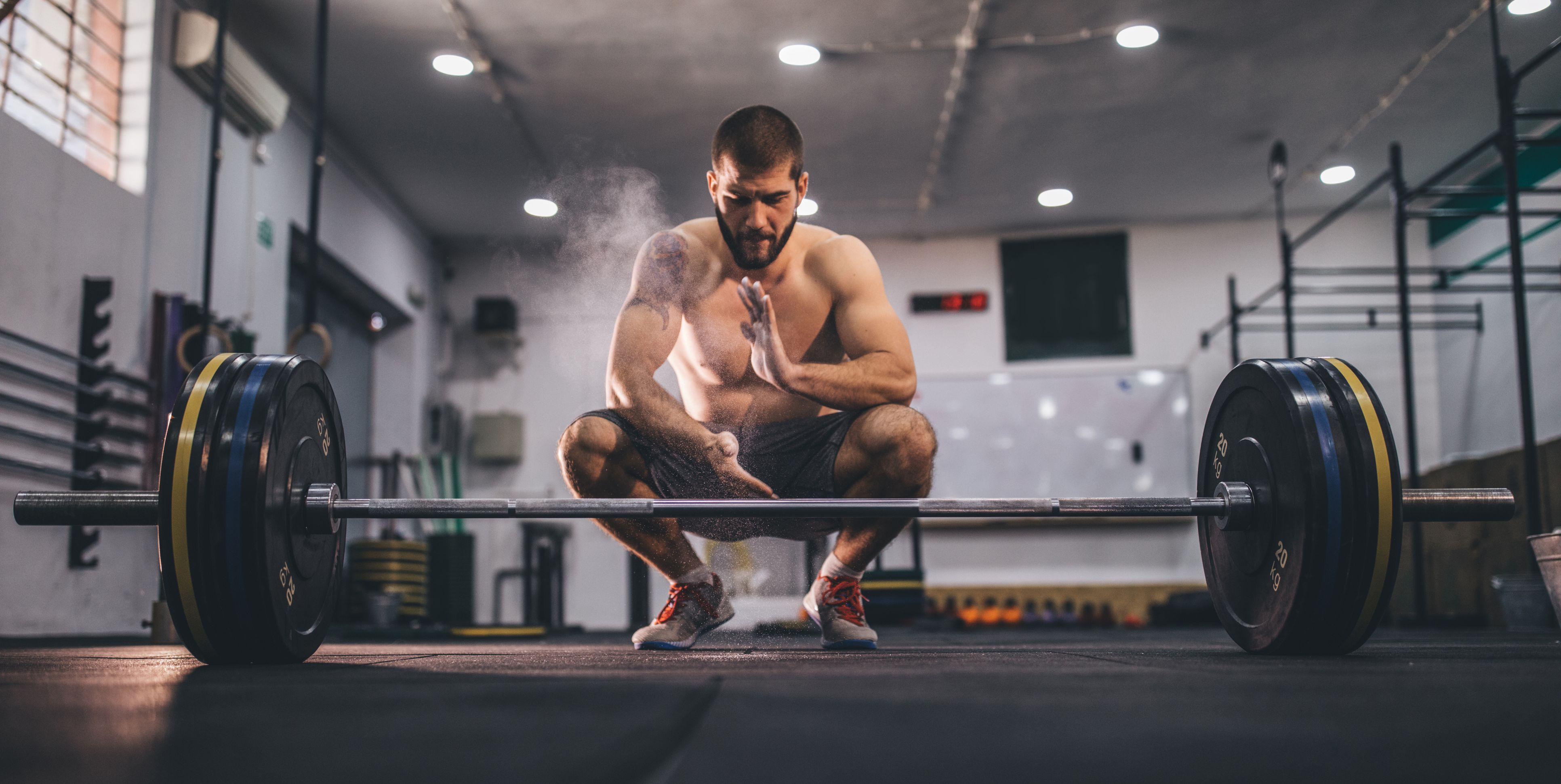 Strong man doing deadlift training in gym