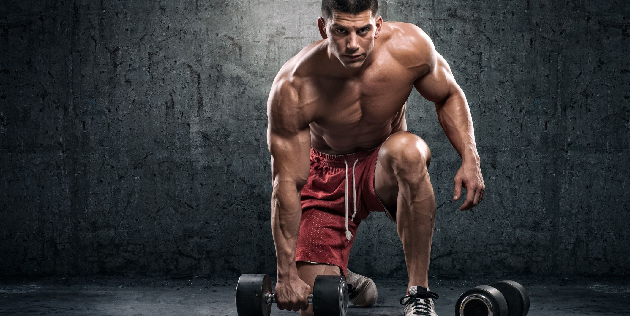 Strongman with dumbbells