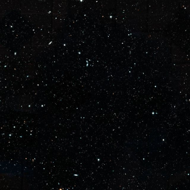 """this hubble space telescope image represents the largest, most comprehensive """"history book"""" of galaxies in the universethe image, a combination of nearly 7,500 separate hubble exposures, represents 16 years' worth of observationsthe ambitious endeavor, called the hubble legacy field, includes several hubble deep field surveys, including the extreme deep field xdf, the deepest view of the universe the wavelength range stretches from ultraviolet to near infrared light, capturing all the features of galaxy assembly over timethe image mosaic presents a wide portrait of the distant universe and contains roughly 265,000 galaxies they stretch back through 133 billion years of time to just 500 million years after the universe's birth in the big bang the tiny, faint, most distant galaxies in the image are similar to the seedling villages from which today's great galaxy star cities grew the faintest and farthest galaxies are just one ten billionth the brightness of what the human eye can seethe wider view contains 100 times as many galaxies as in the hubble ultra deep field, taken in 2004 the new portrait, a mosaic of multiple snapshots, covers almost the width of the full moon lying in this region is the xdf, which penetrated deeper into space than this legacy field view however, the xdf field covers less than one tenth of the full moon's diameter"""