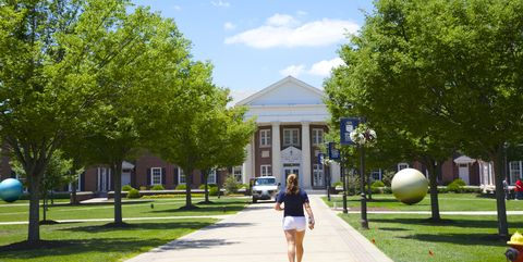 Student walking on College of NJ campus