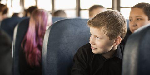 Students sitting on school bus