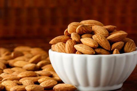 Studio shot of almonds in porcelain bowl