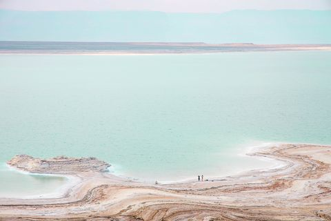 stunning colors of the dead sea with tiny people