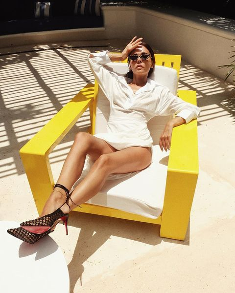 Yellow, Leg, Fashion, Footwear, Sitting, Thigh, Sunglasses, Human leg, Fashion model, Shoe,