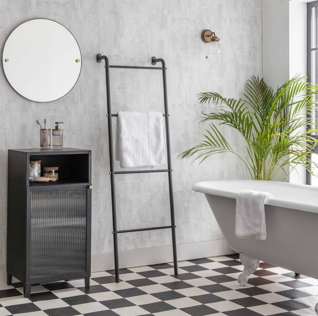 stylish bathroom with tiles and a free standing bath from garden trading