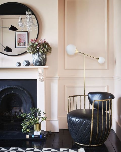 stylish living room corner with leather chair and light
