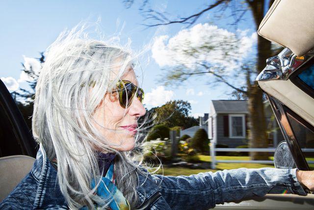 stylish woman driving a convertible