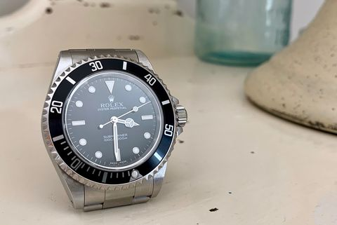 submariner watch on white table