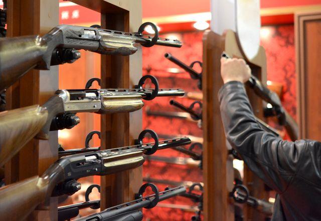 types of guns   submachine gun on the wall