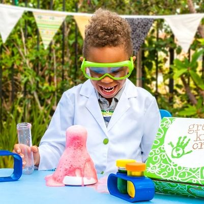 little boy playing with science kit
