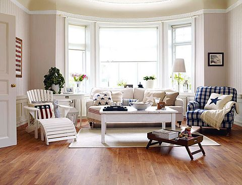 Living room, Furniture, Room, White, Laminate flooring, Interior design, Floor, Wood flooring, Coffee table, Property,