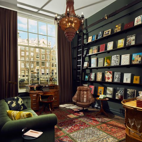 Room, Interior design, Building, Bookcase, Living room, Furniture, Wall, Property, Library, Shelving,