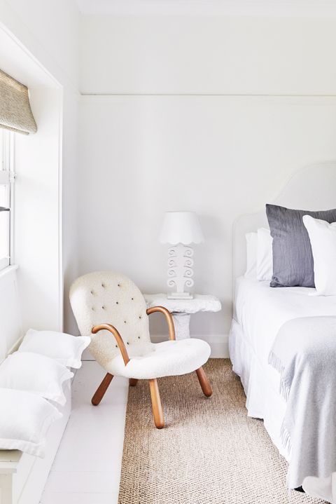 contemporary white bedroom with coastal decor