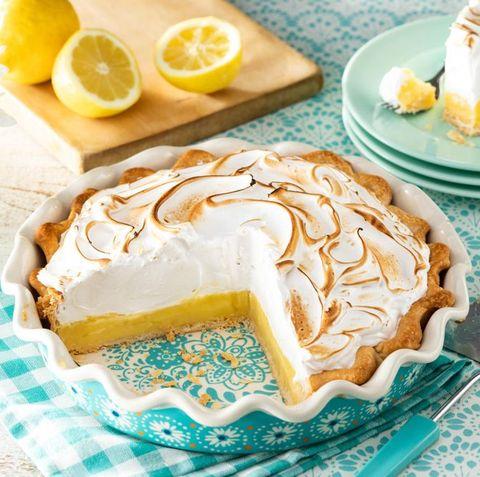 classic lemon meringue pie in teal pw pie pan lemons in back