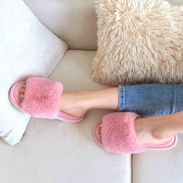 pink fuzzy slipper slides on couch