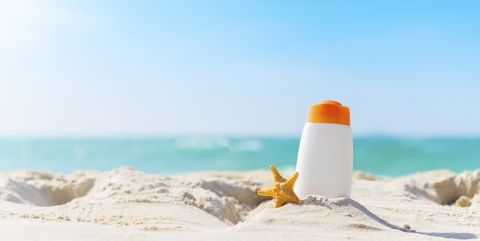 Summer time on the beach with sunblock.