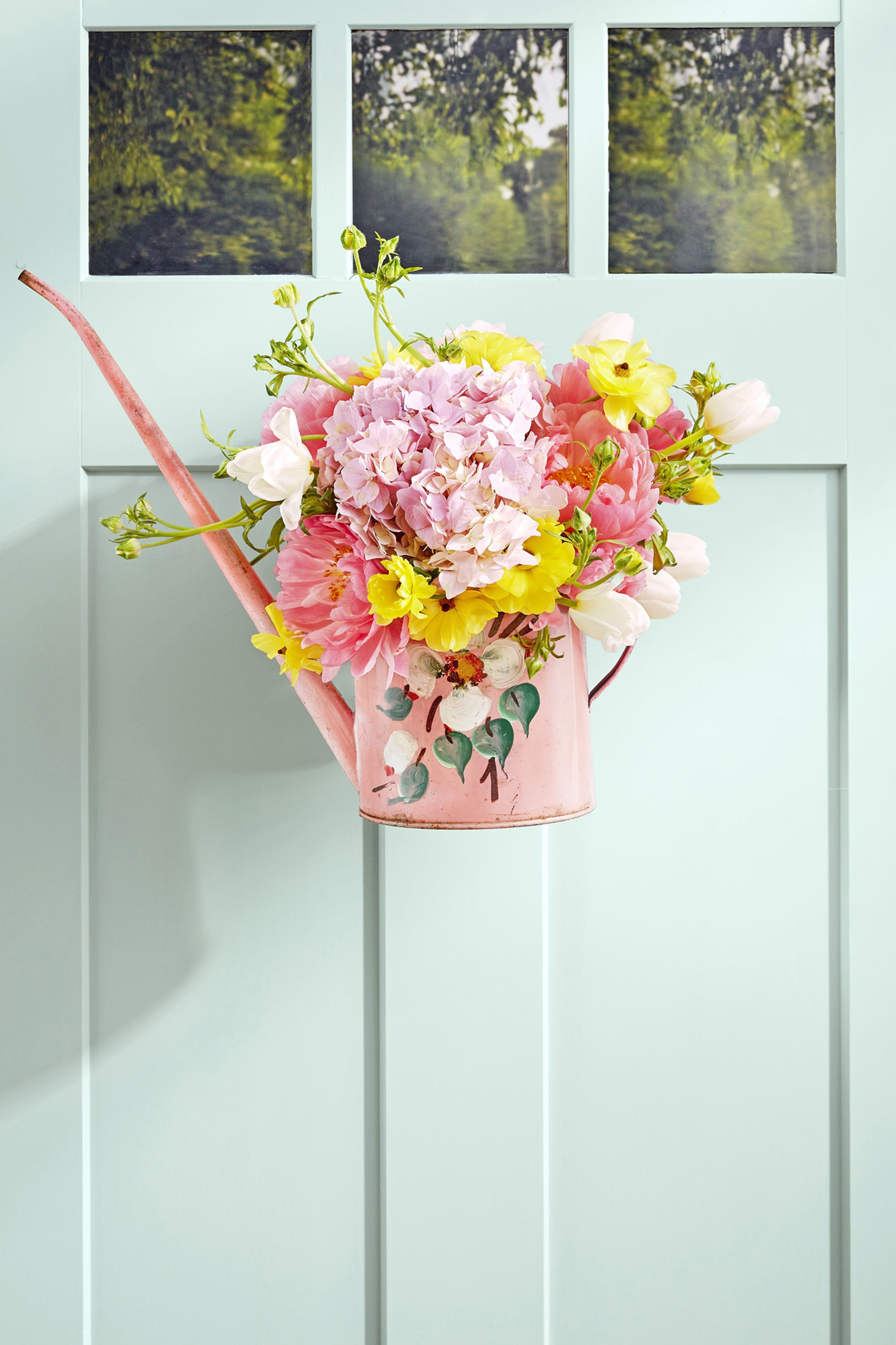 summer wreaths watering can