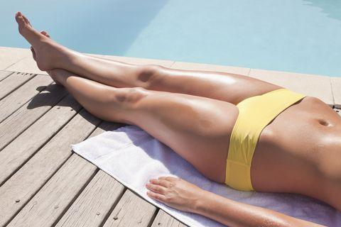 Sun tanning, Leg, Human leg, Thigh, Muscle, Bikini, Abdomen, Arm, Undergarment, Summer,